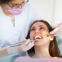 Woman receiving professional teeth cleaning