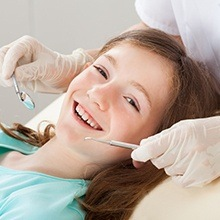 Smiling young girl at dental office