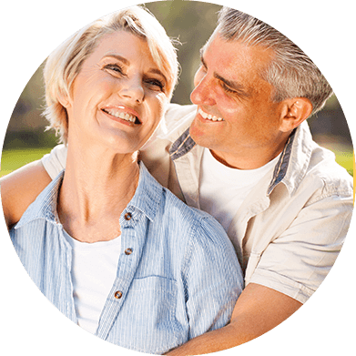 Smiling adult man and woman outdoors