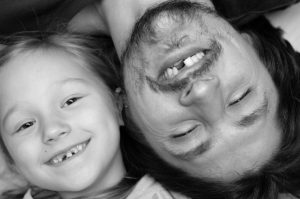 Father and daughter smiling with missing teeth. Get tooth loss facts from your Virginia Beach Dentist.