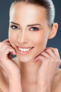 a woman with a beautiful smile thanks to the CEREC virginia beach residents prefer