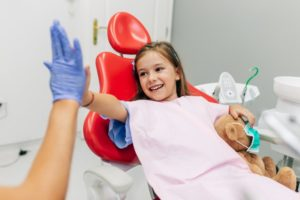 Little girl high-fives her Virginia Beach family dentist