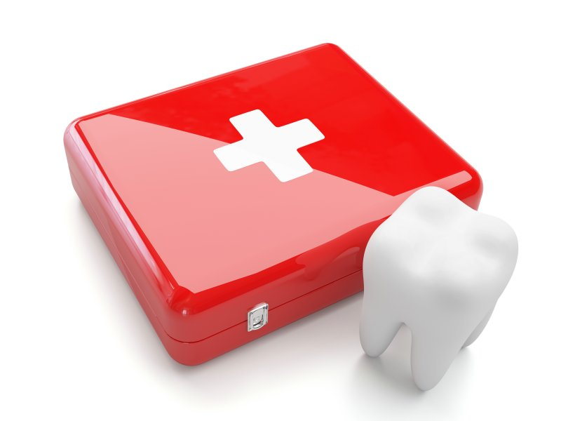 3D tooth next to first aid box