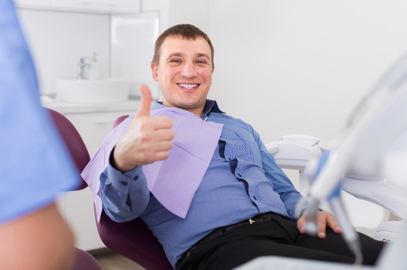 Man giving thumbs up at dentist's appointment